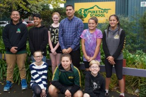 Puketapu School's new Principal Ngatai Walker, with a group of Year 8 students.